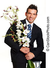 Man with flowers of Orchids