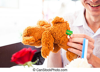 man with fluffy toy bear
