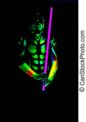 Man with fluorescent bodyart. Black background. Studio shot