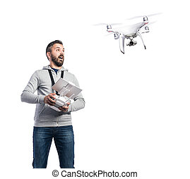 Man with flying drone. Studio shot on white background, ...