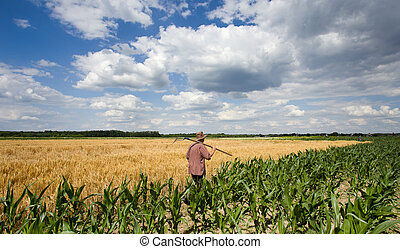 Man with fork in field