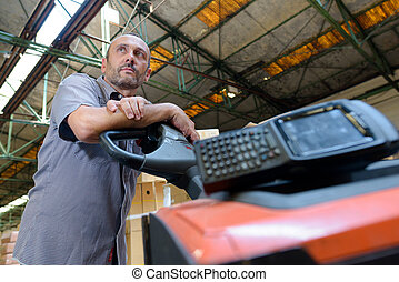 man with forklift at a factory