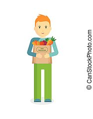 man with fresh vegetables - Man holding craft paper bag with...