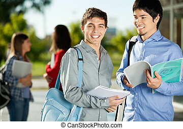 Man With Friend Standing On College Campus