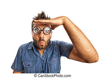 Man with funny expression and thick glasses looking far away.
