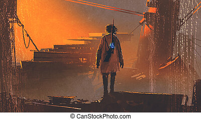 man with futuristic gun standing in abandoned city