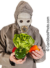 Man with gas mask and vegetables