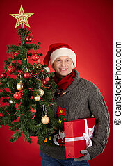 Man with gift and firtree