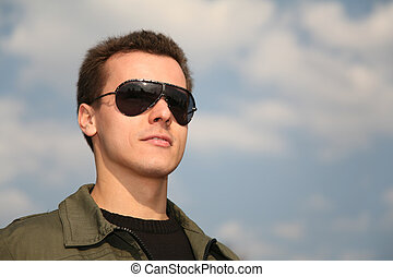 man with glasses on sky