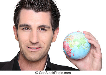 Man with globe in hand