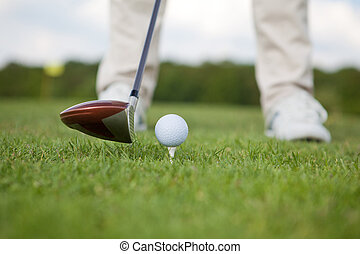 Man With Golf Club And Ball On Course