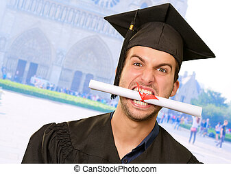 Man With Graduation Certificate In Mouth