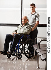 Man With Grandfather Sitting In Wheelchair - Portrait of...