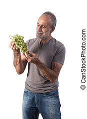 man with grape on white background