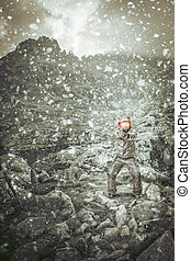 man with gun in mountain