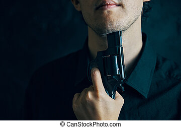 Man with gun is preparing to commit suicide.