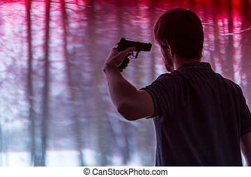 Man with gun - Young depressed man with gun aimed in head