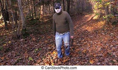 Man with Halloween mask follow the camera