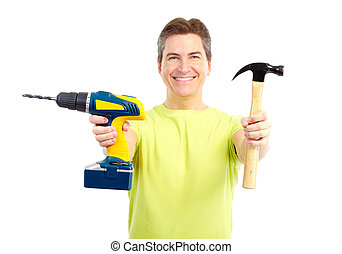 Man with hammer and drill - Handsome man with cordless drill...