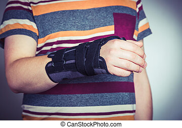 Man with hand in orthopedic black orthosis