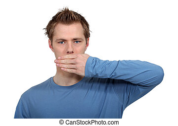 Man with hand on mouth