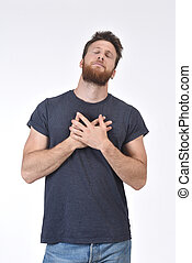 man with hand to the heart on white