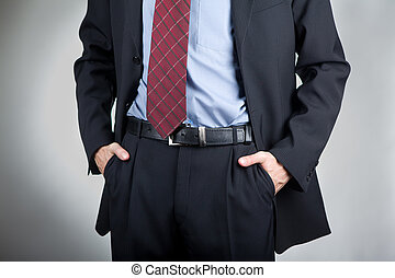 Man with hands in his pocket