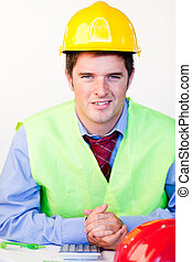 Man with hard hat looking at the camera