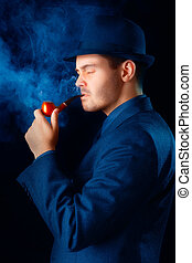 Man with Hat Smoking a Pipe Profile