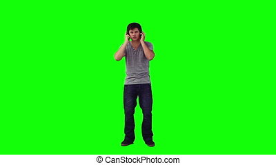 Man with headphones is dancing