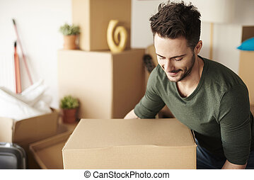 Man with heavy cardboard box