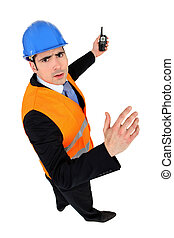 Man with helmet and radio transmitter