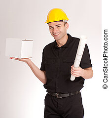 Man with helmet, blueprints and a white box