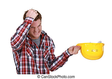 Man with helmet in hand pulling their hair