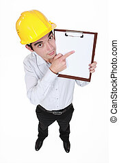 Man with helmet pointing portfolios