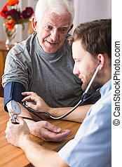 Man with high blood pressure - Photo of old man with high...