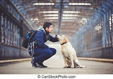 Man with his dog - Man with his yellow labrador retriever on...