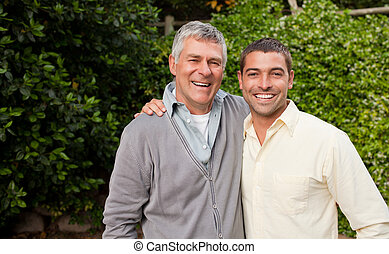 Man with his father looking at the camera