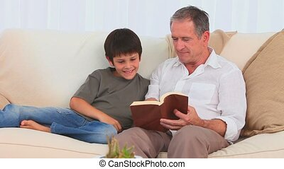 Man with his grandson reading