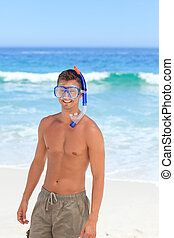 Man with his mask at the beach