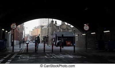 Man with hoodie speaks on the phone - LONDON - Man with...