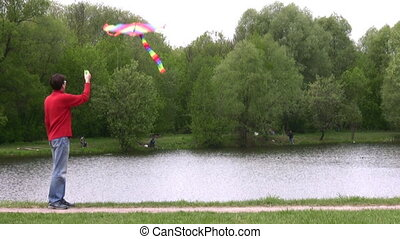 man with kite in park