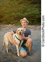 Man with labrador dog