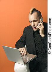 Man with laptop and cellphone.