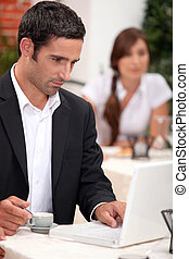 man with laptop in a restaurant