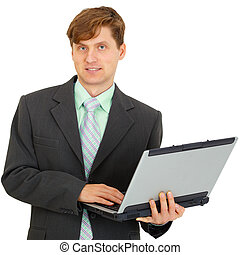 Man with laptop in hand on white background