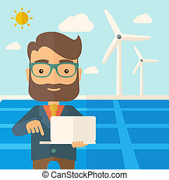 Man with laptop in solar panel.