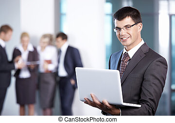 Man with laptop in the office