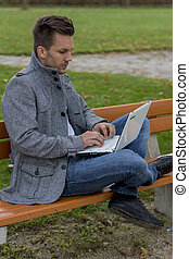man with laptop in the park