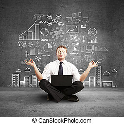 man with laptop meditation